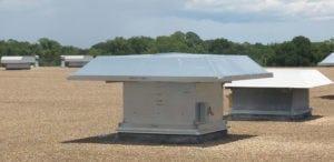 Hooded roof exhaust fan